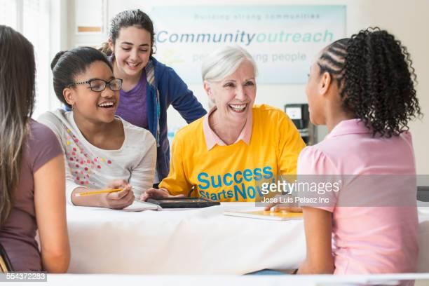 Volunteer tutoring students in classroom