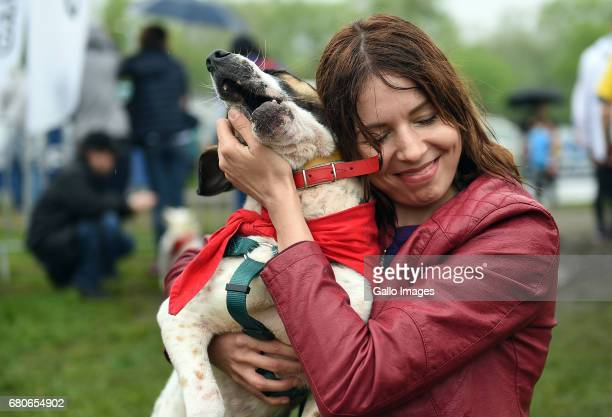 Volunteer with a dog from Paluch participates in the 6th Vegan Run on May 07 2017 in Warsaw Poland During the run not only vegetable cuisine...