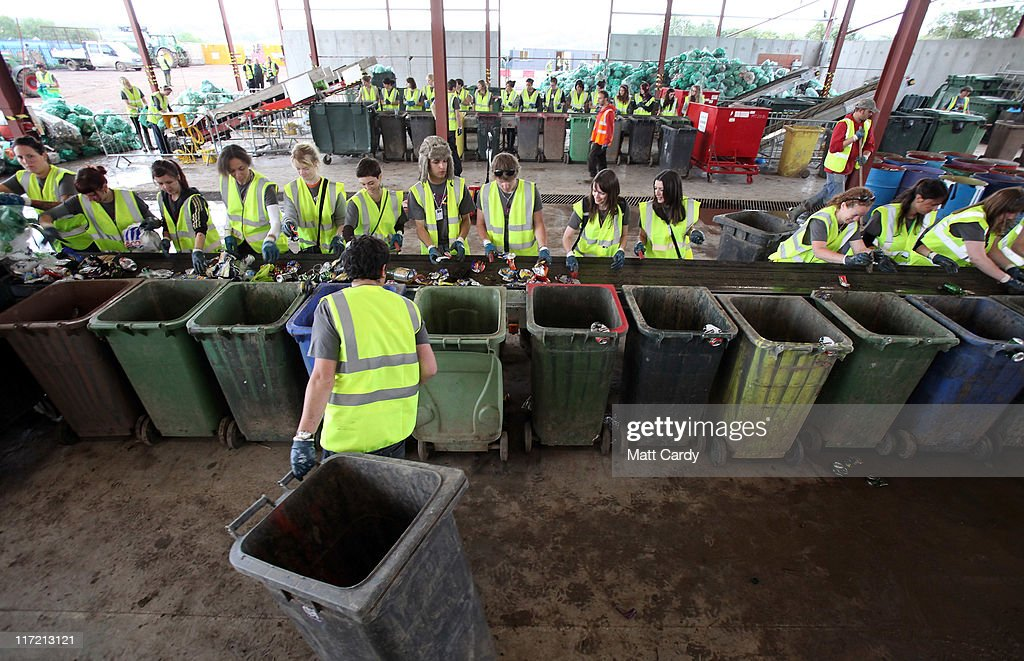 Volunteer workers begin to sort the first of 1000s of tonnes of rubbish for recycling at the Glastonbury Festival recycling centre at the Glastonbury...