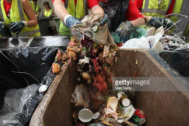 Volunteer workers sort food waste and rubbish for recycling at the Glastonbury Festival recycling centre on June 29 2009 in Glastonbury England Every...