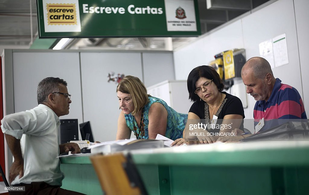 A volunteer writes Christmas letters as part of the state governmental program 'Escreve Cartas' in Sao Paulo Brazil on December 22 2015 Volunteers...