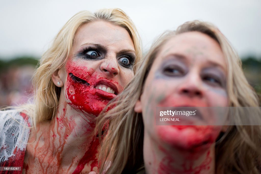 Volunteer 'zombies' prepare to take part in one of Britain's biggest horror events, the 'Zombie Evacuation Race' at Carver Barracks near Saffron Walden, England, on October 5, 2013. The race sees thousands of participants attempt to complete a gruelling 5 kilometre cross-country run, while evading 'zombies', intent on snatching the three life-line strips hanging from every runner's waist. Those who manage to get through with any strips remaining are named as survivors while those without take home an 'infected' badge. AFP PHOTO/Leon Neal
