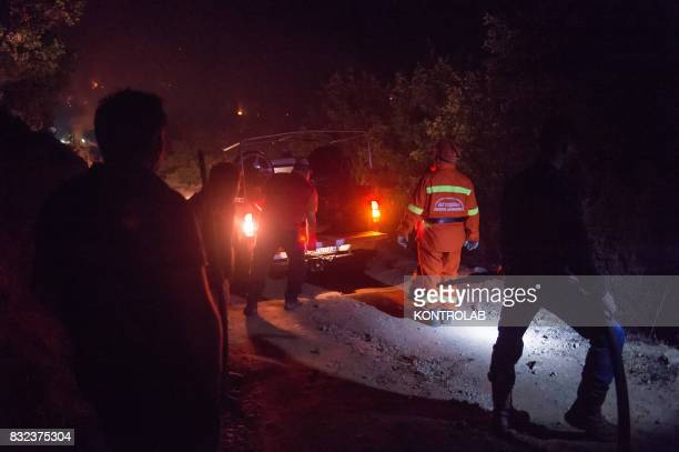 Volunteers and citizens work to extinguish a vast fire in Sila in Calabria southern Italy