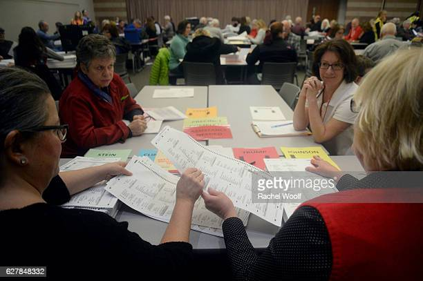 Volunteers and city officials recount presidential ballots at the Oakland Schools Conference Center on December 5 2016 in Waterford Township Michigan...