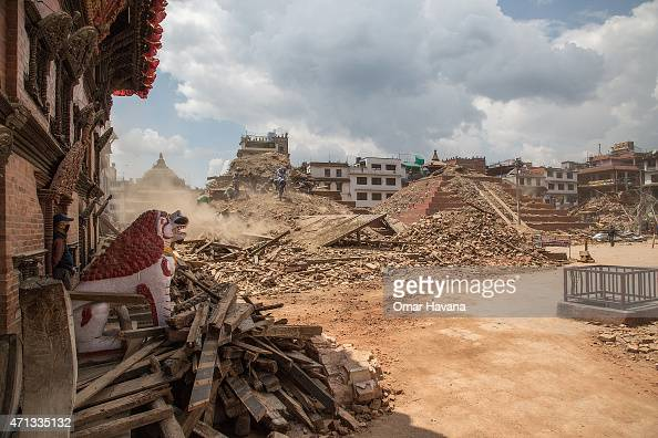 Volunteers and emergency workers search for bodies buried under the debris of the temples at Basantapur Durbar Square on April 27 2015 in Kathmandu...