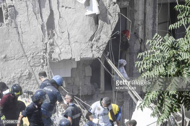 Volunteers and fire fighters work uninterruptedly to try to recover the eight dispersed under the ruins of the collapsed palace at Torre Annunziata...