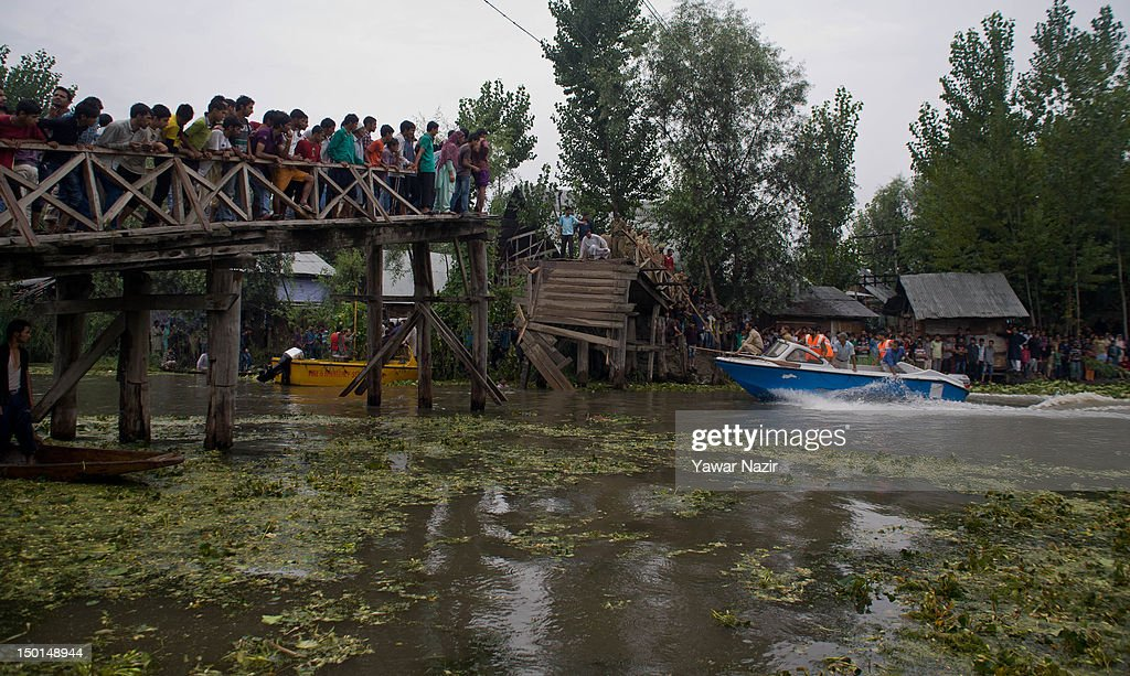 Volunteers and rescuers search for survivors in the water after a footbridge collapsed into the water of on August 11, 2012 in Srinagar, the summer capital of Indian administered Kashmir, India. According to witnesses and ocals many people were injured some of them critically after an old makeshift foot bridge partially crumbled down due to overweight, in the interiors of Dal Lake .