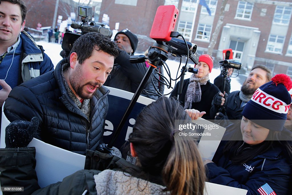 Volunteers and staff for Republican presidential candidate Sen. Marco Rubio (R-FL) face off with trackers and demonstrators from the American Bridge 21st Century political action committee outside the polling place at Webster School February 9, 2016 in Manchester, New Hampshire. With a good showing in the Iowa caucuses, Rubio has stepped into the crosshairs of fellow Republicans running for president and super PACs that want to slow his momentum with attacks on what they call his robotic and repetative messaging.