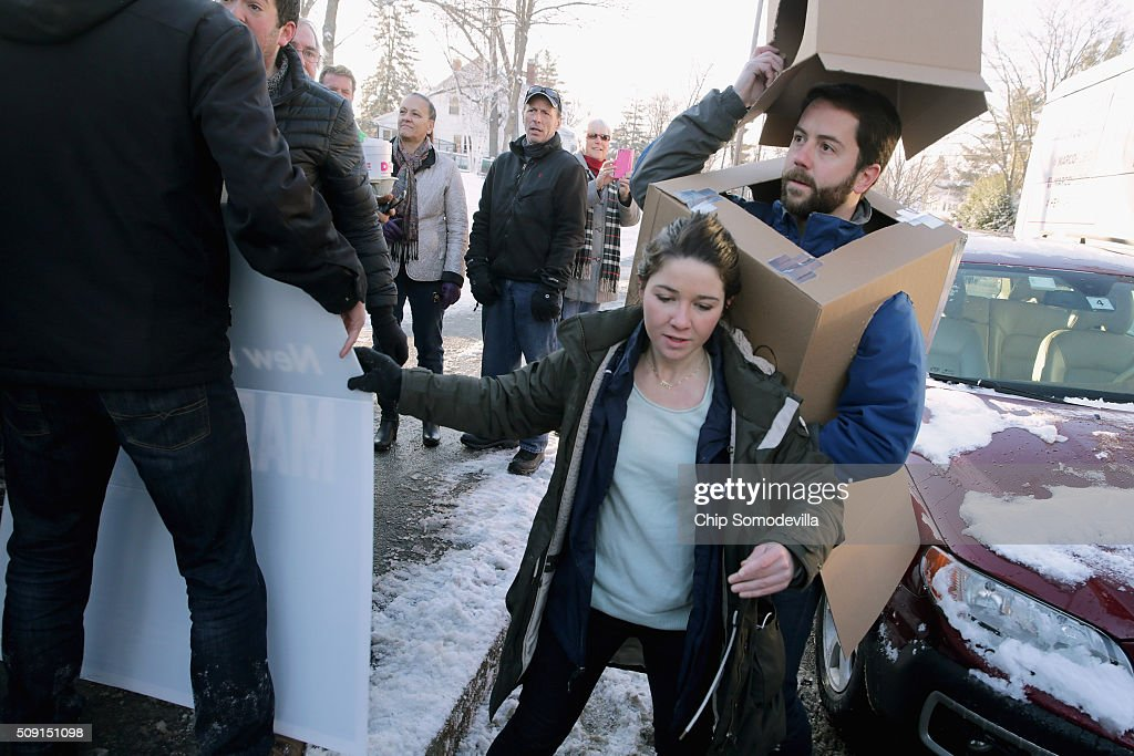 Volunteers and staff for Republican presidential candidate Sen. Marco Rubio (R-FL) along with trackers and demonstrators, including Kevin McAlister of the American Bridge 21st Century political action committee, pushed, shoved and wrestled as Rubio stopped to thank supporters outside the polling place at Webster School February 9, 2016 in Manchester, New Hampshire. With a good showing in the Iowa caucuses, Rubio has stepped into the crosshairs of fellow Republicans running for president and super PACs that want to slow his momentum with attacks on what they call his robotic and repetative messaging.