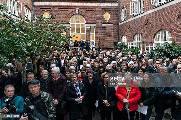Volunteers and staff gather in the atrium of the Danish Mother's Aid's new family council house where they await the arrival of Crown Princess Mary...