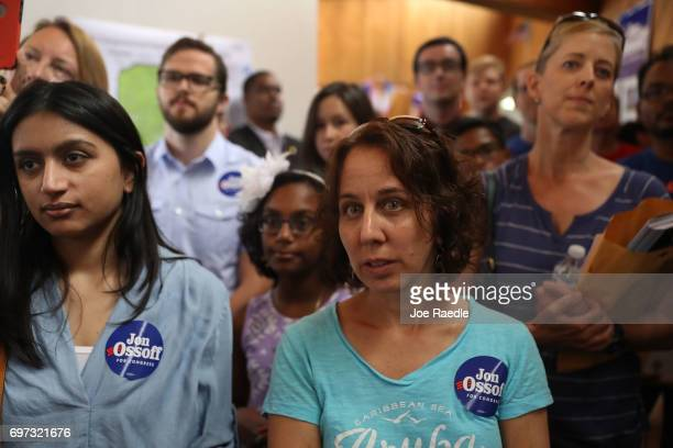 Volunteers and supporters listen as Democratic candidate Jon Ossoff thanks them during a stop at a campaign office as he runs for Georgia's 6th...