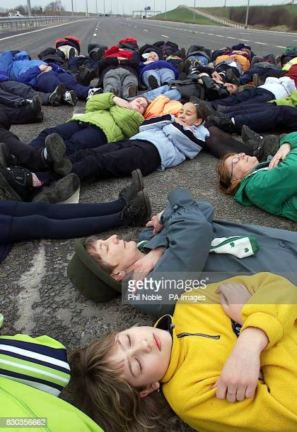 70 volunteers and supporters of road safety group Brake 'play dead' on the unopened M60 motorway in Manchester to represent the 70 people who die...