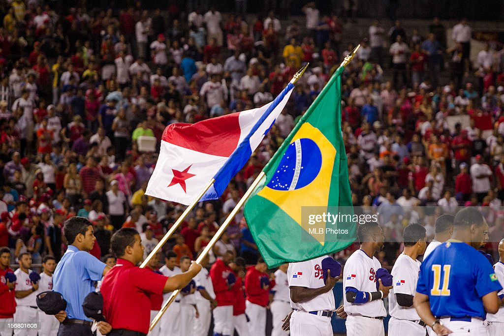 Volunteers are seen on the field holding the flags of Panama and Brazil before Game 6 of the Qualifying Round of the World Baseball between Team Panama and Team Brazil on Monday, November 19, 2012 in Panama City, Panama.
