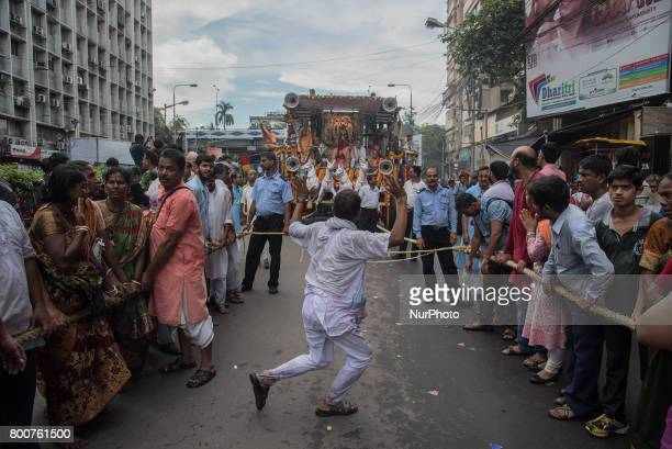 Volunteers are trying their best to keep the crowd away from the path during rath yatra in Kolkata India on 2562017Rath Yatra or the cart festival is...