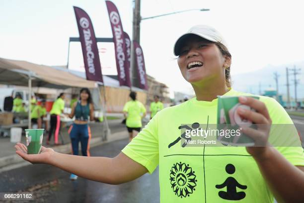 Volunteers as seen at the water station during the United Airlines Guam Marathon 2017 on April 9 2017 in Guam Guam