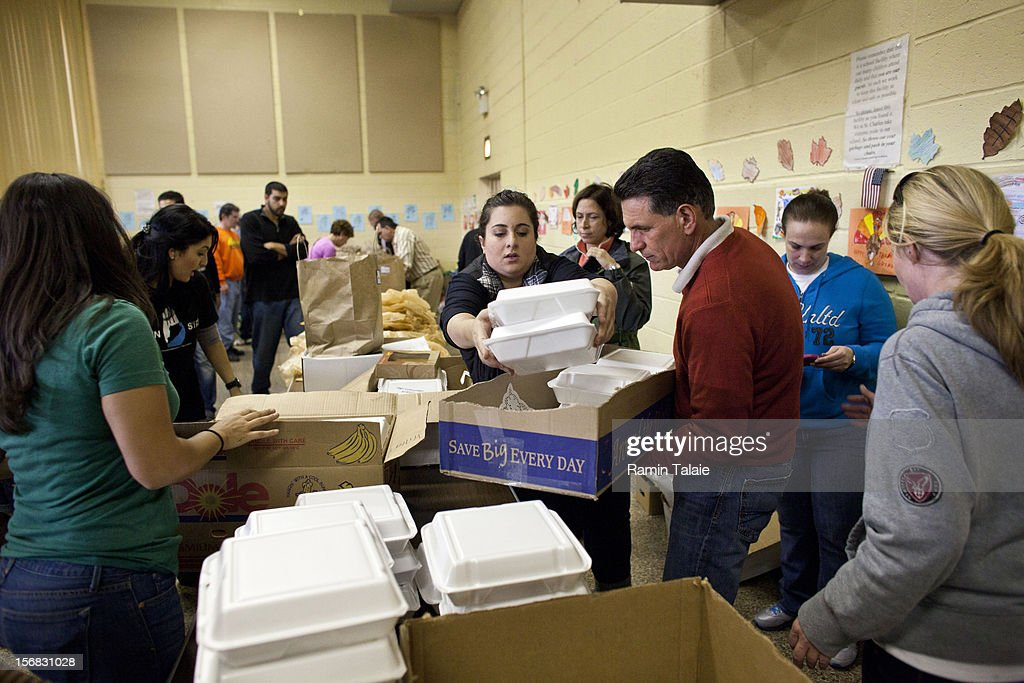 Volunteers at Saint Charles Church prepare boxes with Thanksgiving meals to be delivered to the victims of Superstorm Sandy on November 22, 2012 in the Staten Island borough of New York City. Sections of Staten Island were hard hit by flooding from Superstorm Sandy.