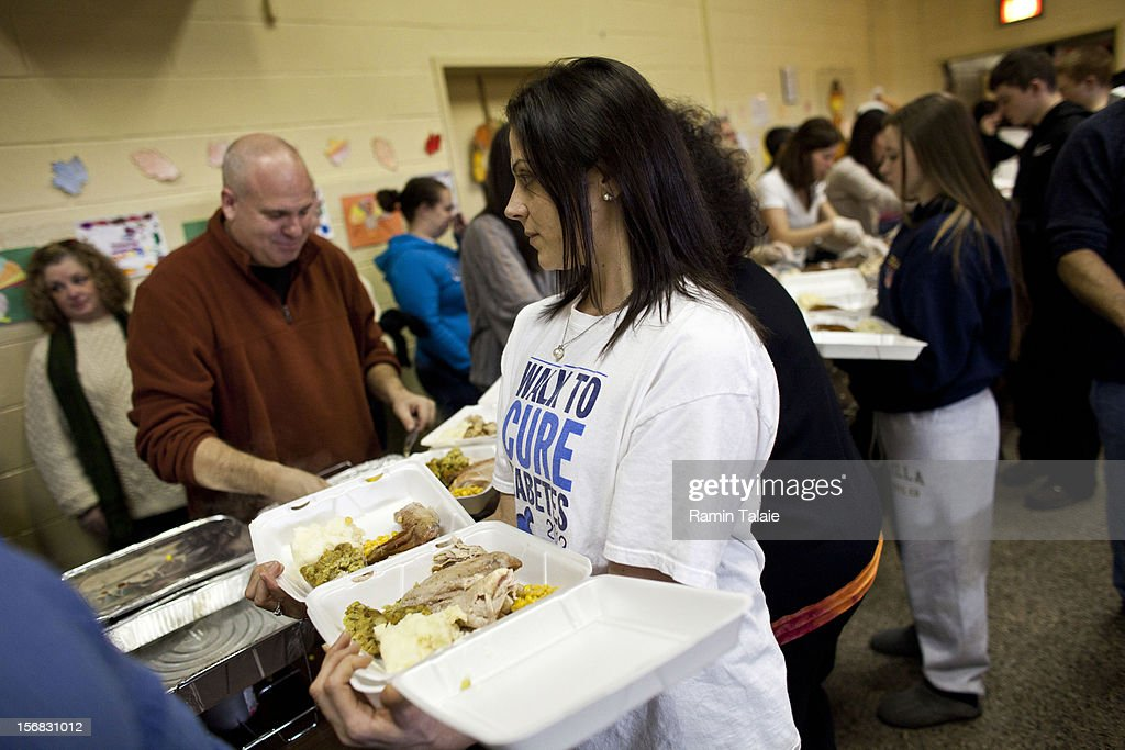 Volunteers at Saint Charles Church prepare Thanksgiving meals to be delivered to the victims of Superstorm Sandy on November 22, 2012 in the Staten Island borough of New York City. Sections of Staten Island were hard hit by flooding from Superstorm Sandy.