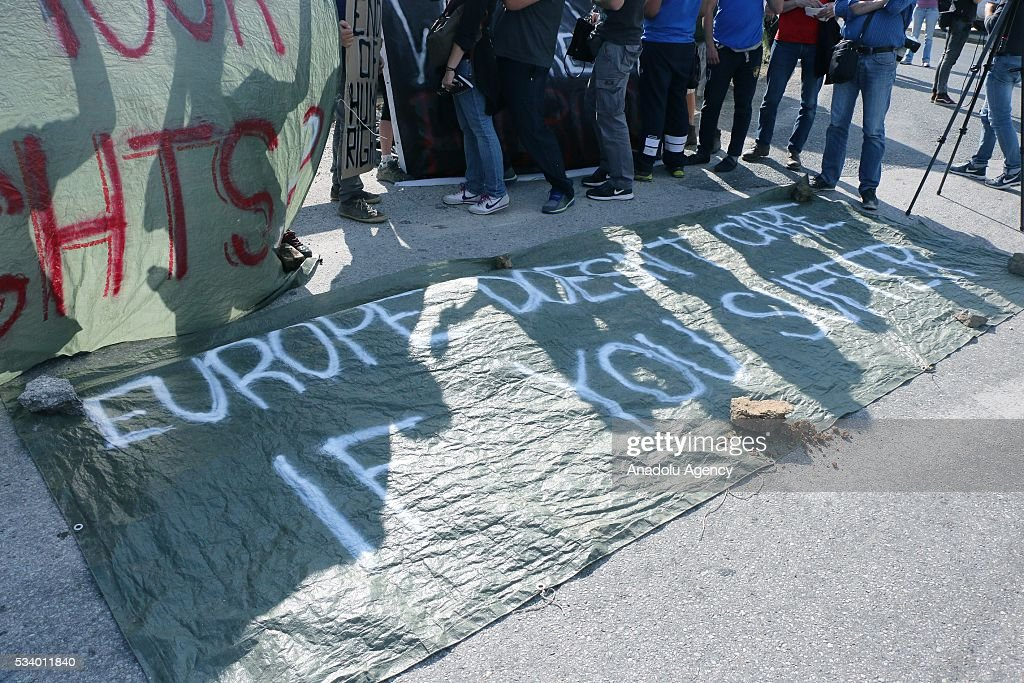 Volunteers at the Idomeni refugee camp area protest as Greek police began to evacuate the makeshift refugee camp at the Greek-Macedonian border near the northern Greek village of Idomeni on May 24, 2016.