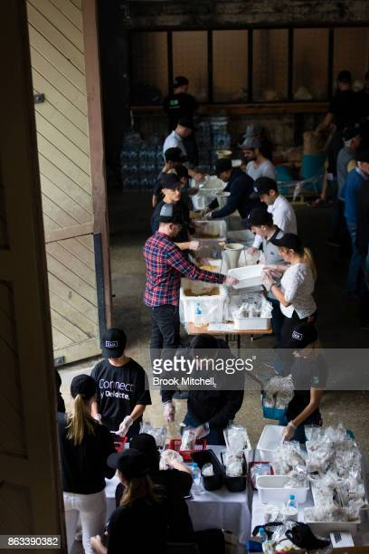 Volunteers at work during Zambrero's meal packing day on October 20 2017 in Sydney Australia More than 1700 volunteers across Australia come together...