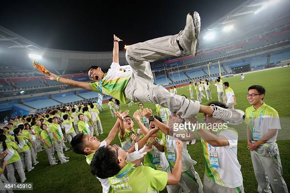 Volunteers attend a farewell party after the matches during day nine of Nanjing 2014 Summer Youth Olympic Games at the Nanjing Olympic Sports Centre...
