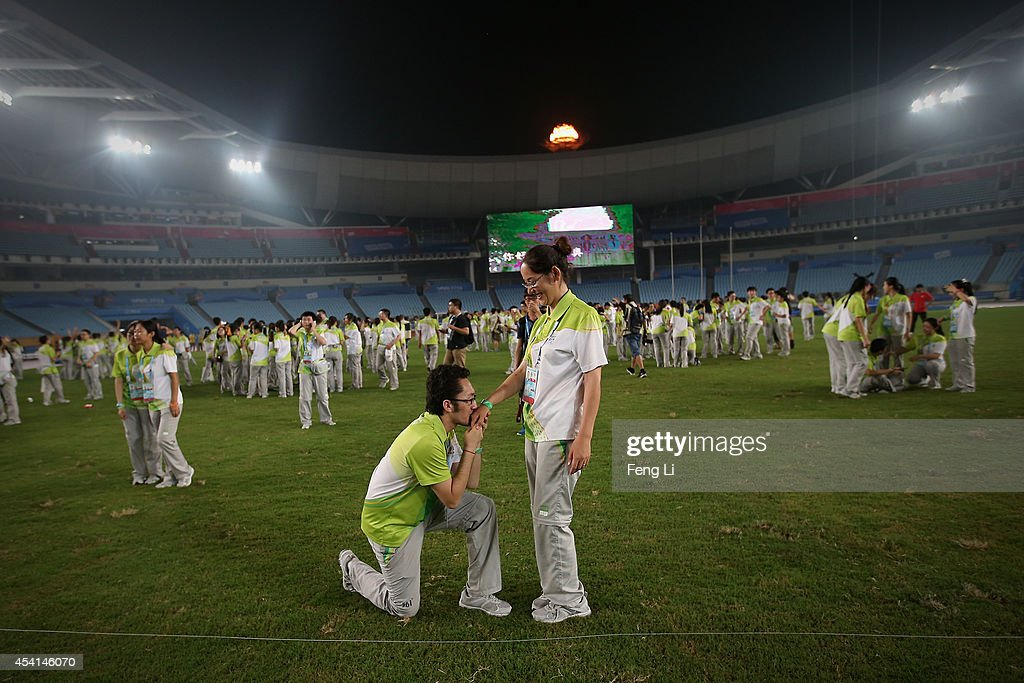 Volunteers attend a farewell party after the matches during day nine of Nanjing 2014 Summer Youth Olympic Games at the Nanjing Olympic Sports Centre on August 25, 2014 in Nanjing, China.