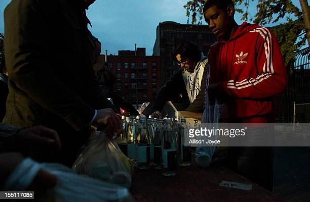 Volunteers bag basic supplies like diapers food and water November 1 2012 in New York City Limited public transit has returned to New York With the...