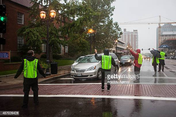 Volunteers called 'Marshalls' direct traffic around the District Prosecutors offices where protestors take part in a rally as part of the Ferguson...