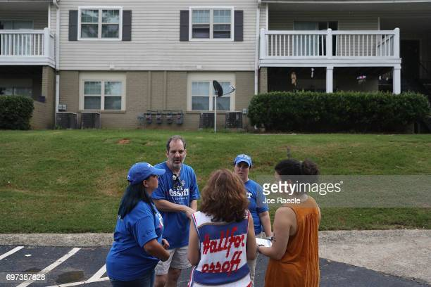 Volunteers canvass a neighborhood for Democratic candidate Jon Ossoff as he runs for Georgia's 6th Congressional District on June 18 2017 in Chamblee...
