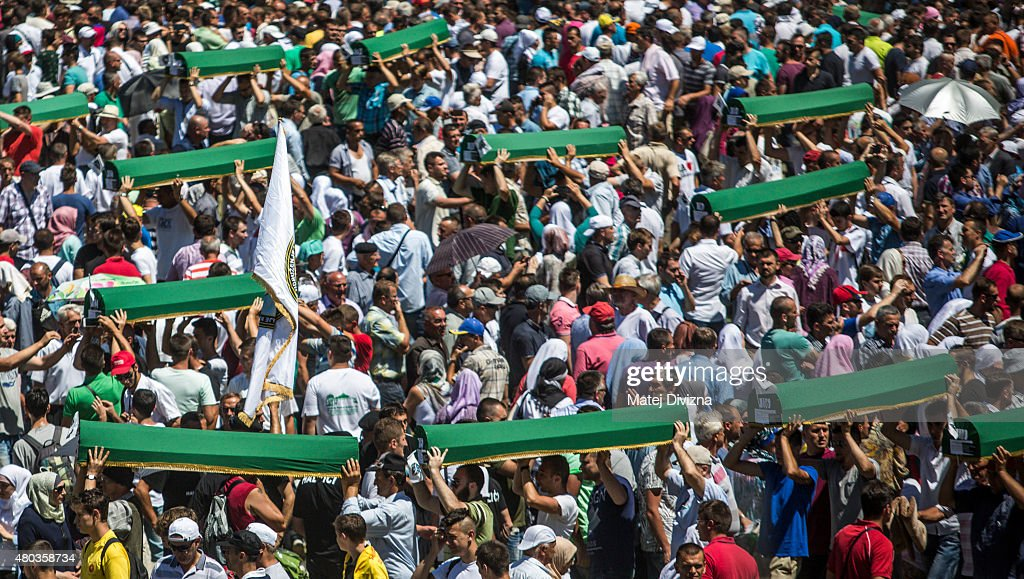 Volunteers carry some of the 136 coffins newly-identified victims of the 1995 Srebrenica massacre to their graves during the 20th anniversary of the massacre at the Potocari cemetery and memorial on July 11, 2015 in Srebrenica, Bosnia and Herzegovina. At least 8,300 Bosnian Muslim men and boys who had sought safe heaven at the U.N.-protected enclave at Srebrenica were killed by members of the Republic of Serbia (Republika Srpska) army under the leadership of General Ratko Mladic, who is currently facing charges of war crimes at The Hague, during the Bosnian war in 1995.