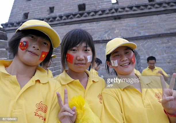 Volunteers cheer during the Olympic Torch relay along a section of the Great Wall in Badaling outside Beijing on August 07 2008 a day before the 2008...