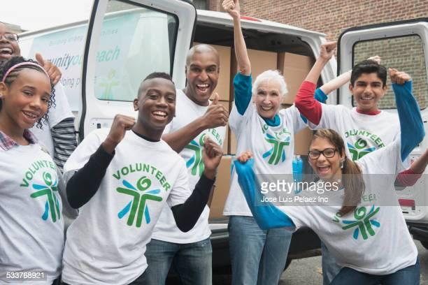 Volunteers cheering near delivery van