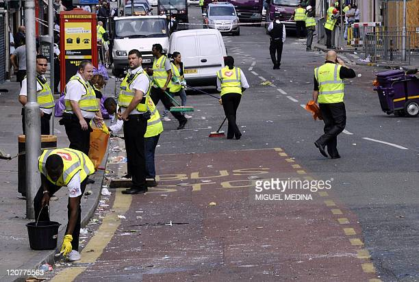 Volunteers clean London road in Croydon south of London on August 10 following riots in the area on Monday night Prime Minister David Cameron said a...
