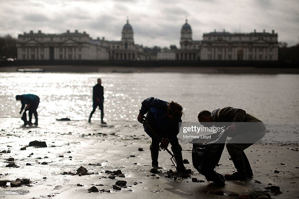 Volunteers clean the banks of the River Thames of rubbish and debris on the Isle of Dogs on March 15, 2013 in London, England. The Thames21 charity leads volunteers in deep cleans of some of the Thames' most polluted and littered areas, using the annual low tides to reach areas normally impossible to access.