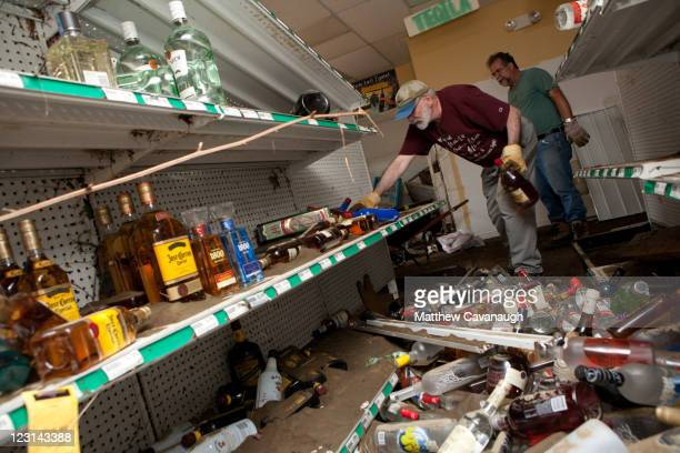 Volunteers clean up bottles at McBreairty's Liquors on West Main Street where Tropical Storm Irene caused severe flooding in the town's center on...