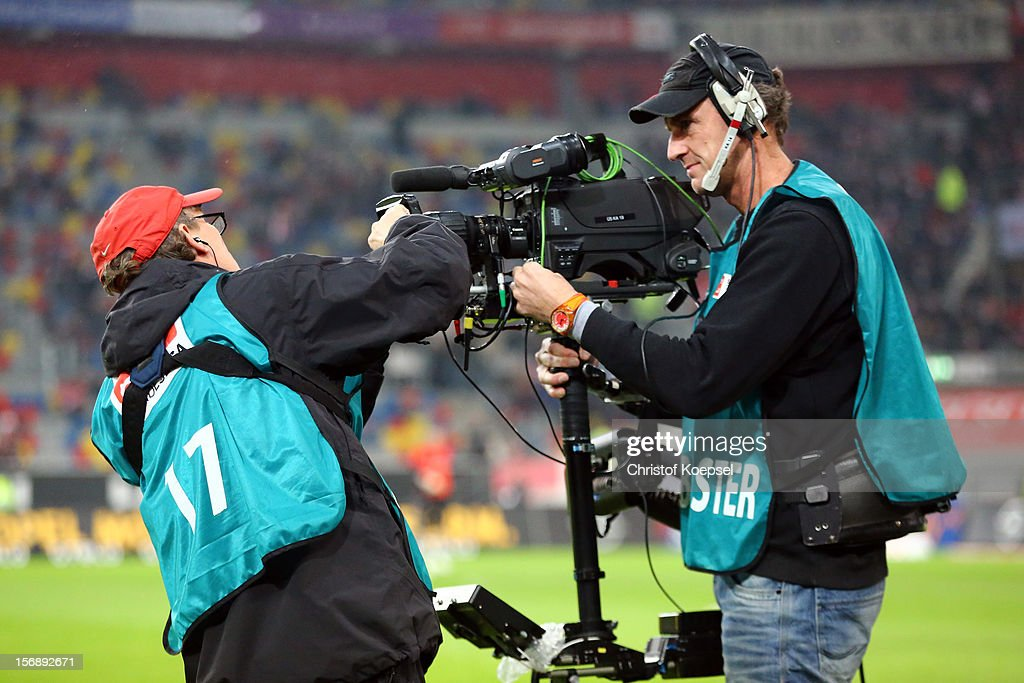 A volunteers cleans a television camera prior to the Bundesliga match between Fortuna Duesseldorf and Hamburger SV at Esprit-Arena on November 23, 2012 in Duesseldorf, Germany.