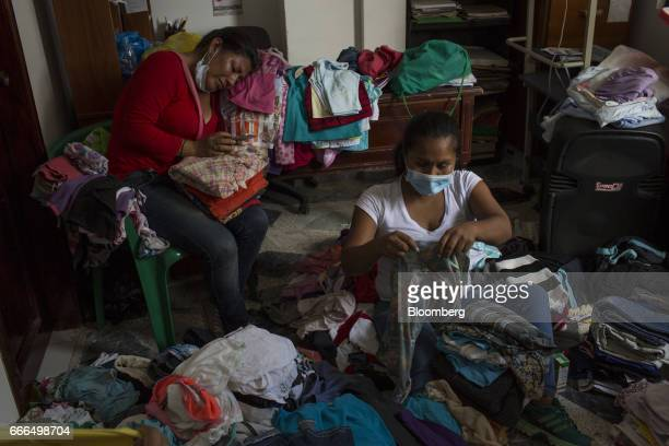 Volunteers collect clean clothes at an Indigenous Organization of Putumayo center after landslides in Mocoa Putumayo Colombia on Monday April 3 2017...