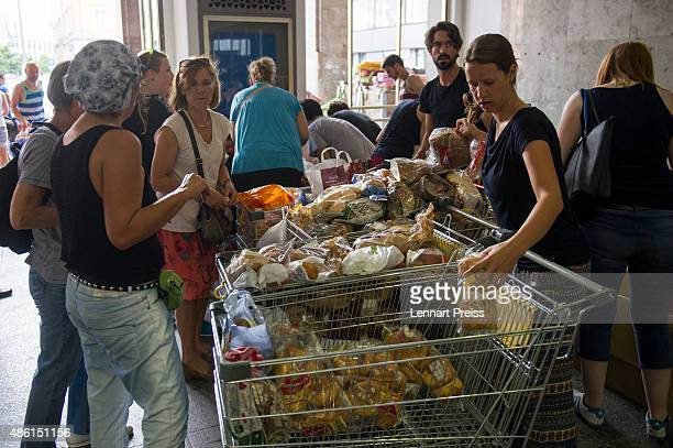 Volunteers collect food for migrants who arrive at Munich Hauptbahnhof main railway station on September 1 2015 in Munich Germany Over a thousand...