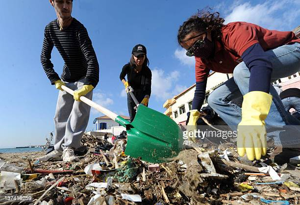 Volunteers collect trash on Tamentfoust beach on January 20 east of Algiers during a cleanup operation AFP PHOTO/FAROUK BATICHE