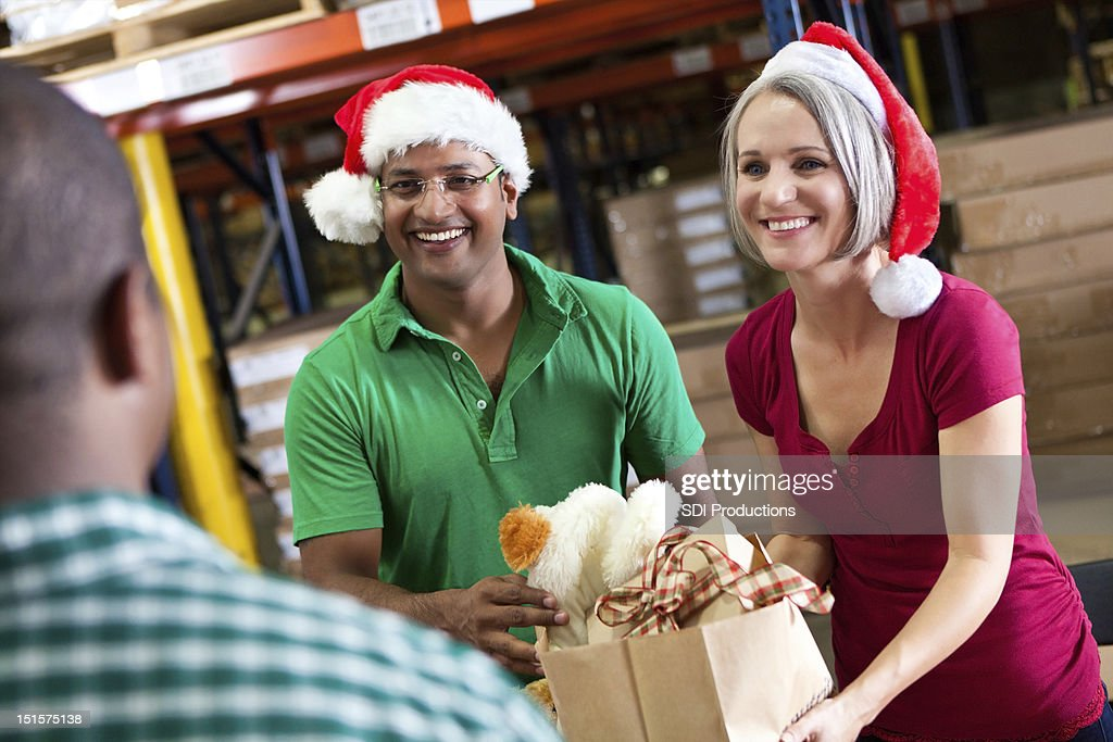 Volunteers collecting donations as a Christmas donation drive : Stock Photo