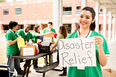 Volunteers: College students collect clothing donations for disaster relief.