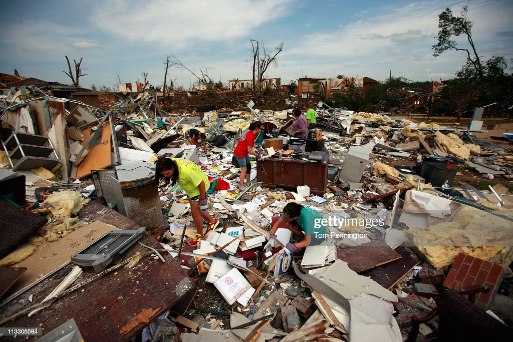 Volunteers comb through the rubble of Alberta Elementary School on May 1, 2011 in Tuscaloosa, Alabama. Alabama, the hardest-hit of six states, is reported to have been battered with at least an EF-4 rated tornado with the death toll across the South rising to over 300 as a result of the storms.