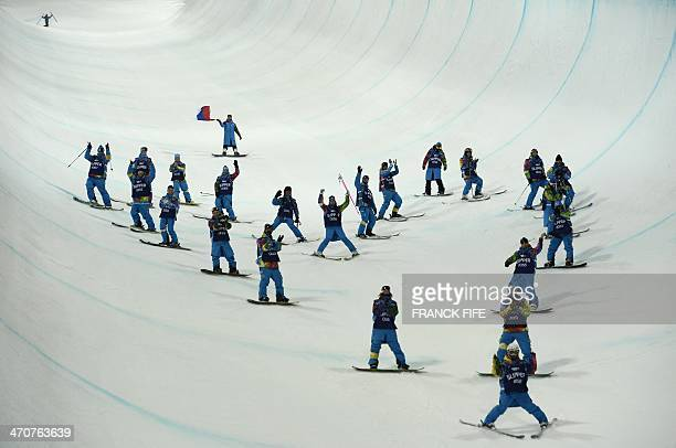 Volunteers come down the halfpipe at the end of the Women's Freestyle Skiing Halfpipe finals at the Rosa Khutor Extreme Park during the Sochi Winter...