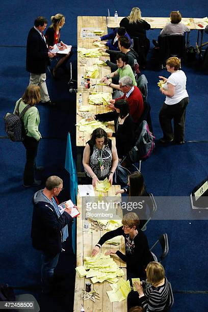 Volunteers count ballot papers inside the English Institute of Sport including ballot papers for the constituency of Sheffield Hallam where Liberal...