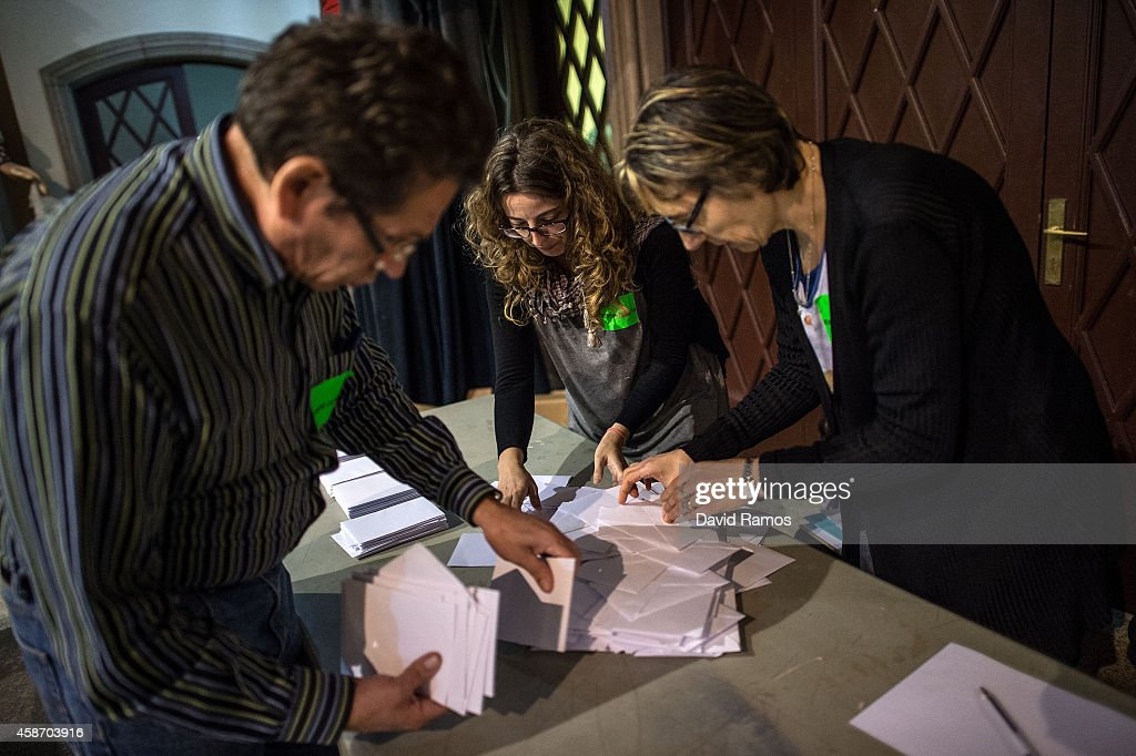 Volunteers count ballots after closing a polling station on November 9 2014 in Barcelona Spain Catalans vote today during an unofficial and...
