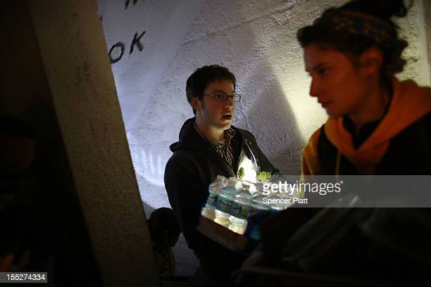 Volunteers deliver water and readytoeat meals to needy residents of the Red Hook Houses where they currently have no water or electricity due to...