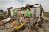 Volunteers demolish a tornadodamaged home July 30 2011 in Joplin Missouri Joplin continues to recover from the May 22nd twister which killed 160...