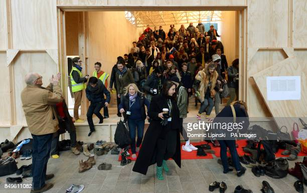 Volunteers depart after taking part in a stress test of the installation 'Black Maria' produced by artist Richard Wentworth in collaboration with...