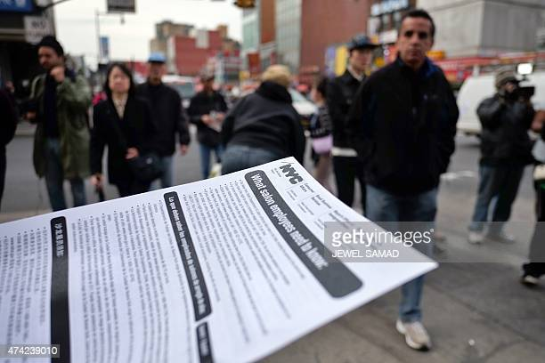 Volunteers distribute flyers in multiple languages about health concerns labor practices regulations and wages at nail salons to commuters outside a...