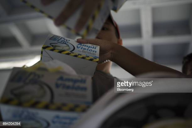 Volunteers distribute protective goggles to protesters before a demonstration in Caracas Venezuela on Wednesday May 31 2017 Theneardaily...