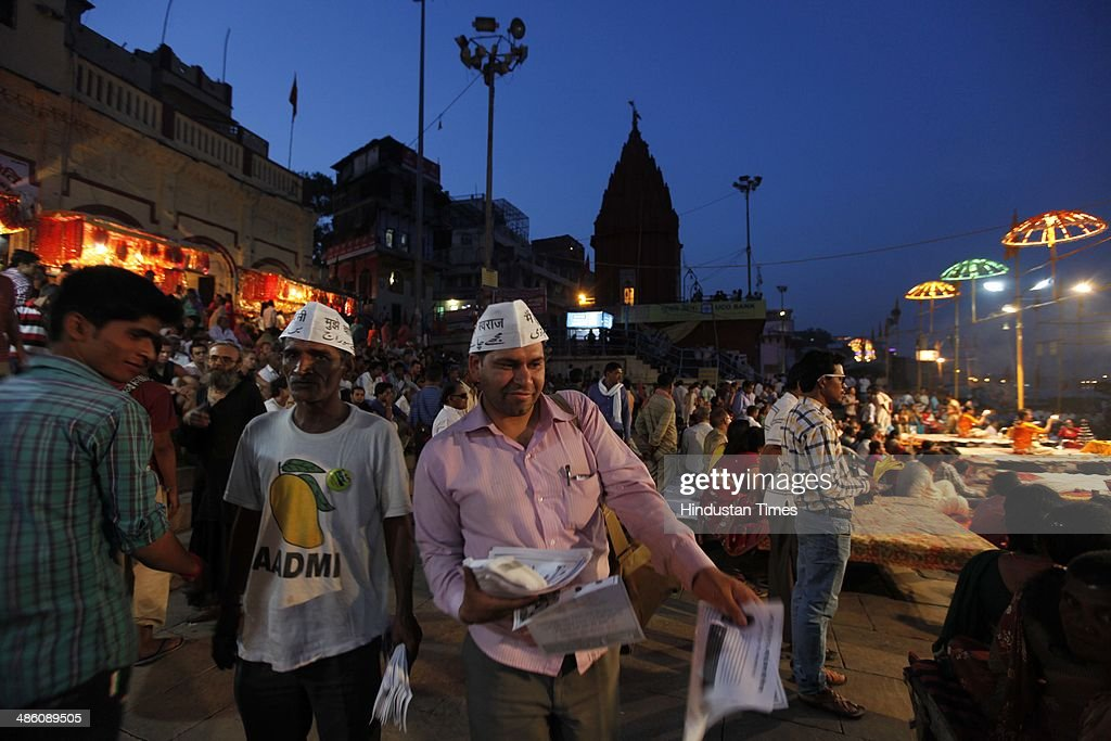 AAP volunteers distributing pamphlets during an election campaign at Dashashavmedh Ghat on April 22, 2014 in Varanasi, India. Narendra Modi will file his nomination from Varanasi on April 24. His rival contestants are Aam Aadmi Party leader Arvind Kejriwal, Ajay Rai of the Congress and Kailash Chaurasia of the Samajwadi Party